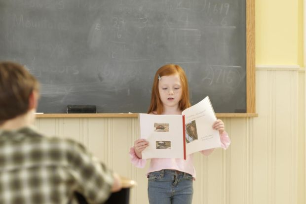 red head girl giving speech