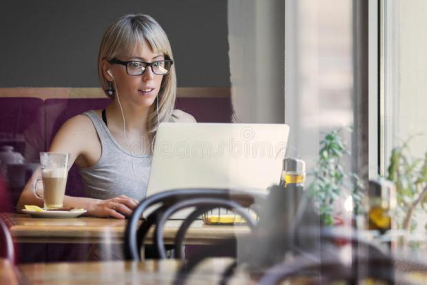 young-woman-working-computer-cafe-concept-anywhere-work-40512548