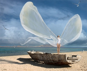 woman-with-wings-on-old-boat-on-sandy-shore